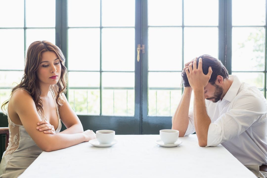 Depressed couple sitting with coffee cup in the restaurant Free Stock Images from PikWizard
