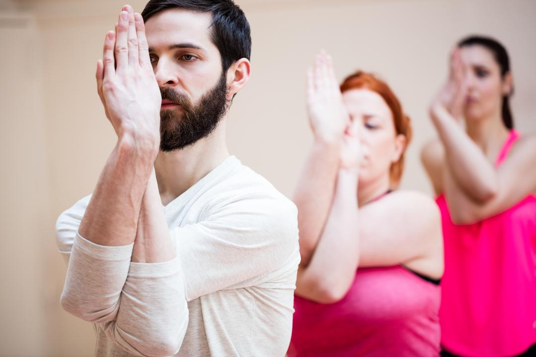 Group of people performing hand exercise in the fitness studio