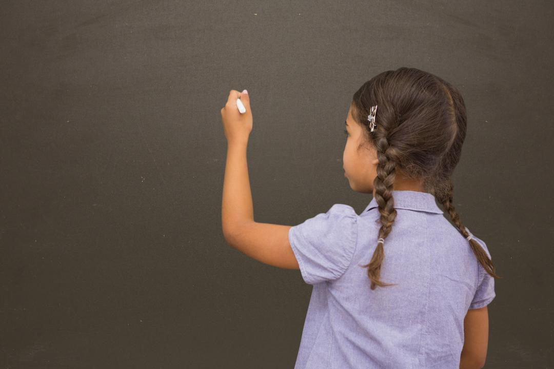 Digital composite of School girl writing on blackboard Free Stock Images from PikWizard