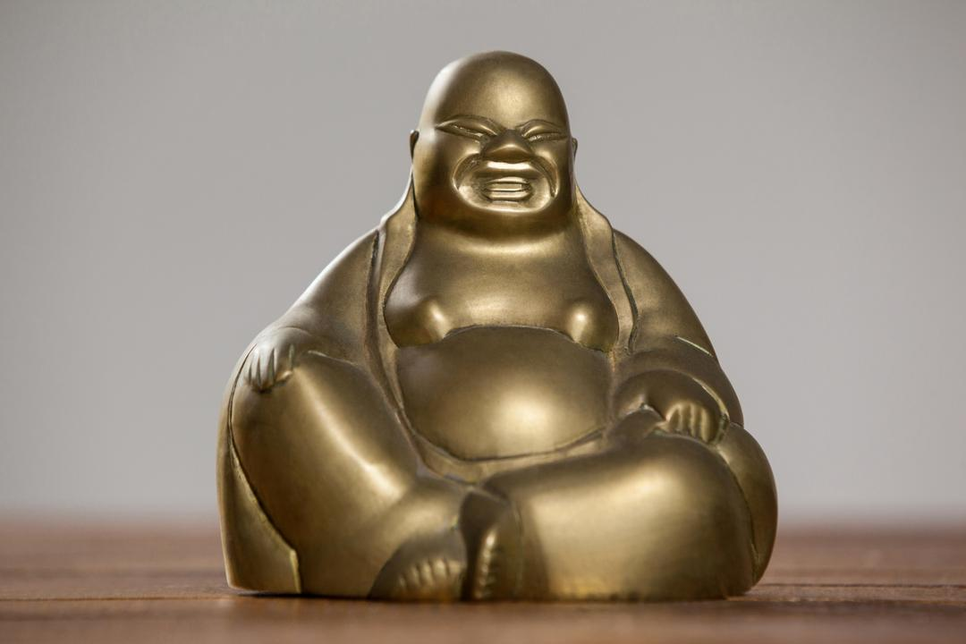 Gold painted laughing buddha figurine