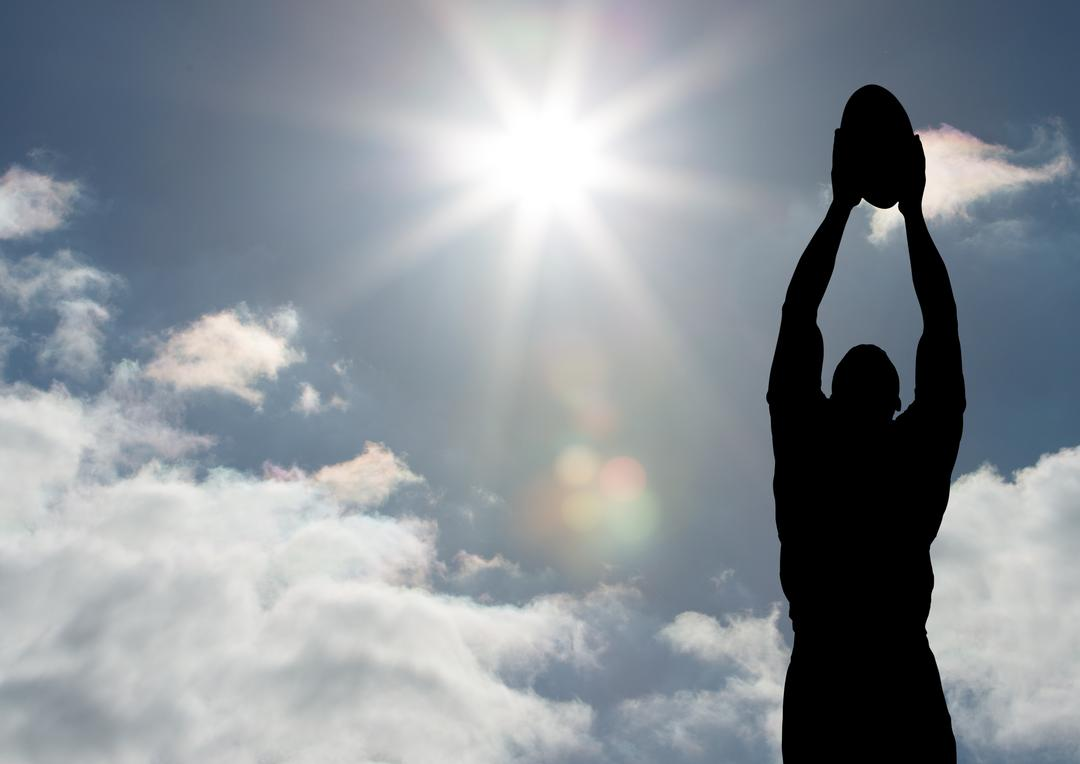 Silhouette male athlete playing rugby on a sunny day