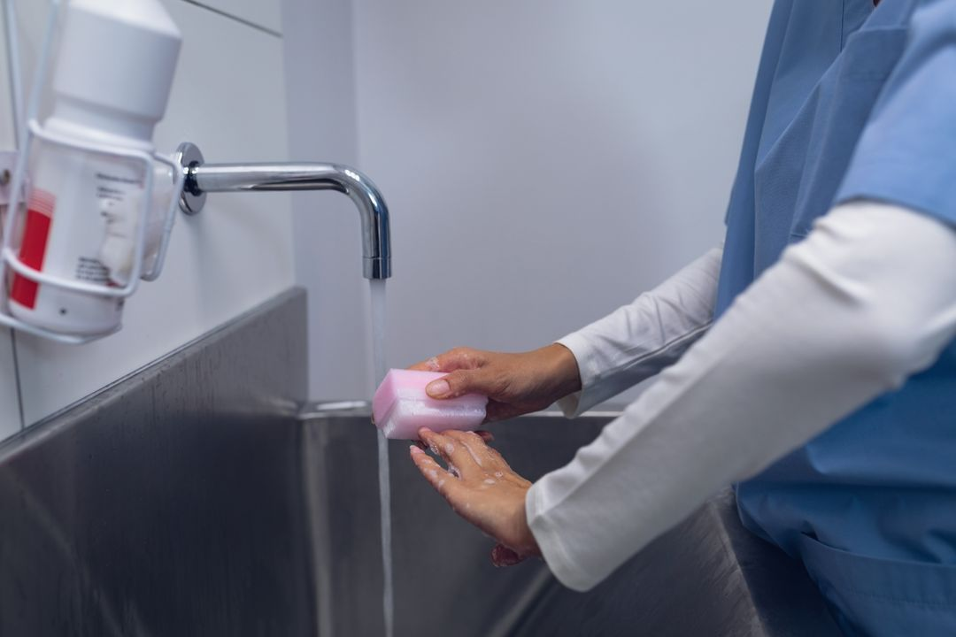 Mid section of female surgeon washing hands on sink at hospital Free Stock Images from PikWizard