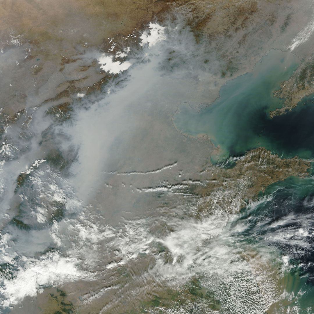 "A thick layer of haze blanketed the North China Plain on October 9, 2014, when the Moderate Resolution Imaging Spectroradiometer (MODIS) on NASA's Terra satellite acquired this natural-color image at 2:50 Coordinated Universal Time (10:50 a.m. local time). The haze obscured many features usually visible in MODIS imagery of the area, including China's largest city, Beijing.  On the day this image was acquired, measurements from ground-based sensors at the U.S. Consulate in Beijing reported PM2.5 measurements of 334 micrograms per cubic meter of air. Fine, airborne particulate matter (PM) that is smaller than 2.5 microns (about one thirtieth the width of a human hair) is considered dangerous because it is small enough to enter the passages of the human lungs. Most PM2.5 aerosol particles come from the burning of fossil fuels and biomass (wood fires and agricultural burning). The World Health Organization considers PM2.5 to be safe when it is below 25.  Haze in this region tends to worsen in the fall and winter, when cold, heavy air traps pollutants near the surface. In this case, the haze was likely trapped by a temperature inversion. Normally, air is warmest near the surface of the Earth. Occasionally, a mass of warm air will move over cooler air so that the atmosphere actually warms with altitude. Since the cool air does not have the energy to rise through the warm air, vertical circulation slows and air becomes trapped near the surface. Any pollutant that enters the air gets trapped as well, and haze builds up over time.  Daily satellite images of the North China Plain show that visible haze began to accumulate on October 7, 2014.  NASA image courtesy Jeff Schmaltz, LANCE MODIS Rapid Response. Caption by Adam Voiland.  Read more: <a href=""http://earthobservatory.nasa.gov/NaturalHazards/view.php?id=84530&amp;eocn=home&amp;eoci=nh"" rel=""nofollow"">earthobservatory.nasa.gov/NaturalHazards/view.php?id=8453...</a>  Credit: <b><a href=""http://www.earthobservatory.nasa.gov/"" rel=""nofollow""> NASA Earth Observatory</a></b>  <b><a href=""http://www.nasa.gov/audience/formedia/features/MP_Photo_Guidelines.html"" rel=""nofollow"">NASA image use policy.</a></b>  <b><a href=""http://www.nasa.gov/centers/goddard/home/index.html"" rel=""nofollow"">NASA Goddard Space Flight Center</a></b> enables NASA's mission through four scientific endeavors: Earth Science, Heliophysics, Solar System Exploration, and Astrophysics. Goddard plays a leading role in NASA's accomplishments by contributing compelling scientific knowledge to advance the Agency's mission. <b>Follow us on <a href=""http://twitter.com/NASAGoddardPix"" rel=""nofollow"">Twitter</a></b> <b>Like us on <a href=""http://www.facebook.com/pages/Greenbelt-MD/NASA-Goddard/395013845897?ref=tsd"" rel=""nofollow"">Facebook</a></b> <b>Find us on <a href=""http://instagram.com/nasagoddard?vm=grid"" rel=""nofollow"">Instagram</a></b>"