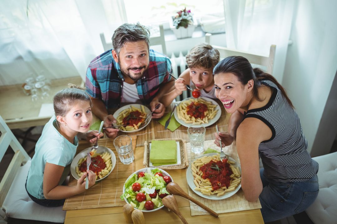 Elevated  view of family having meal together at home