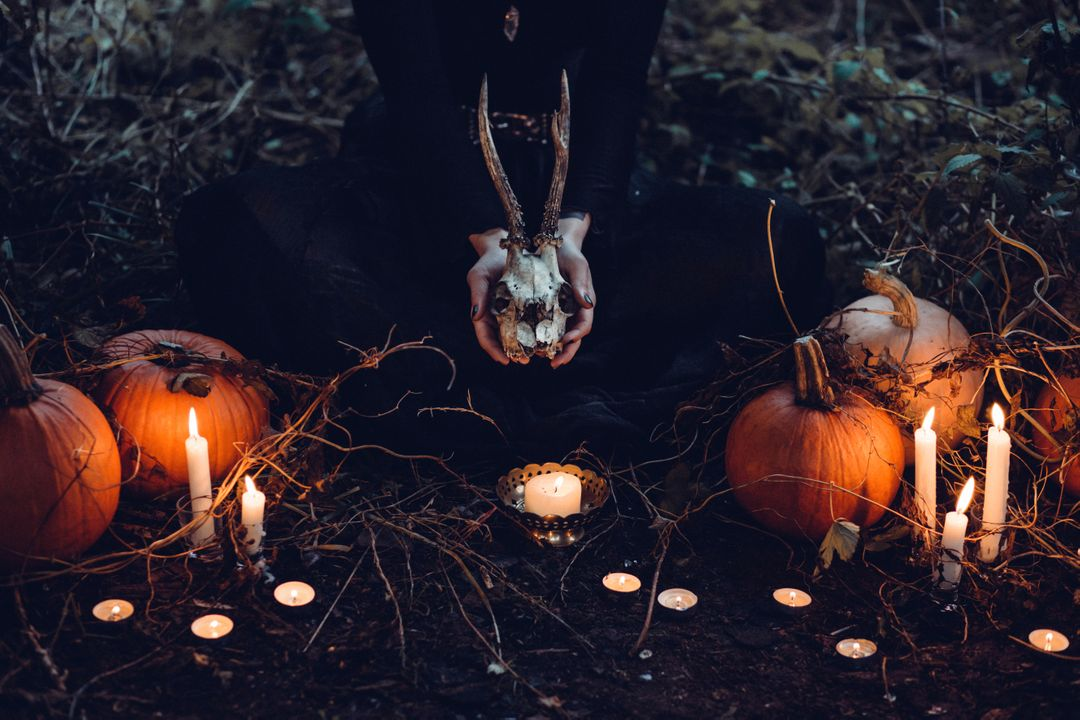 Image of Pumpkins and Candles on the Ground