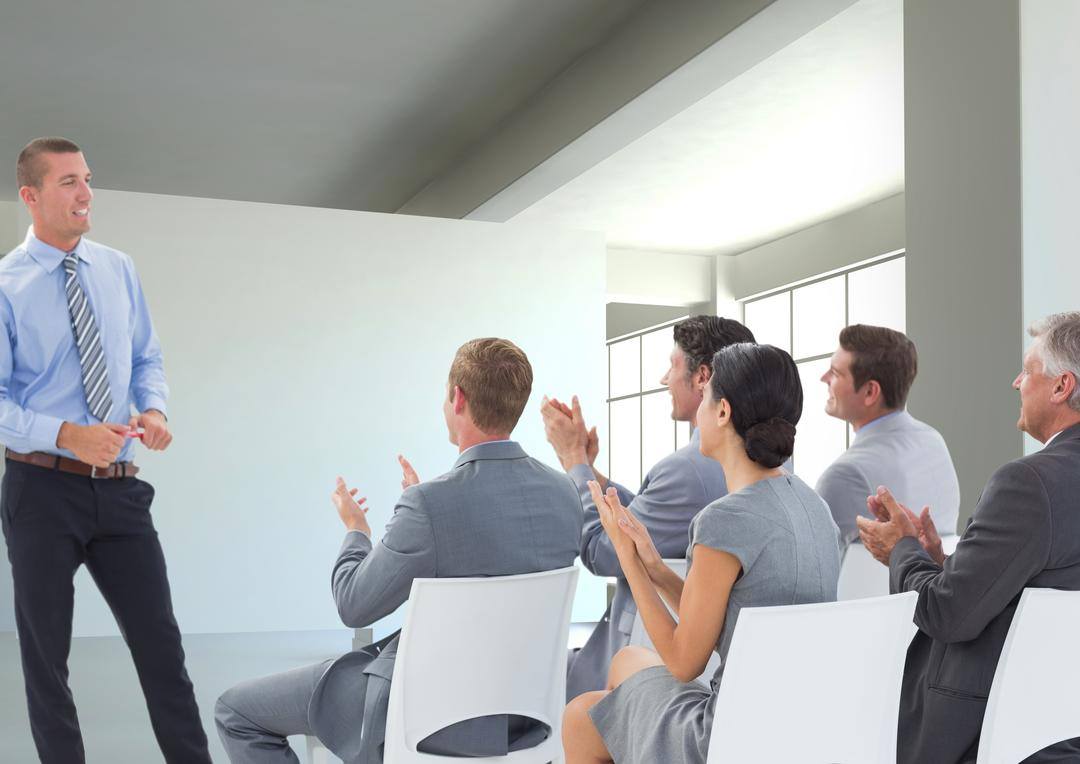Businessman giving presentation in front of his colleagues in office