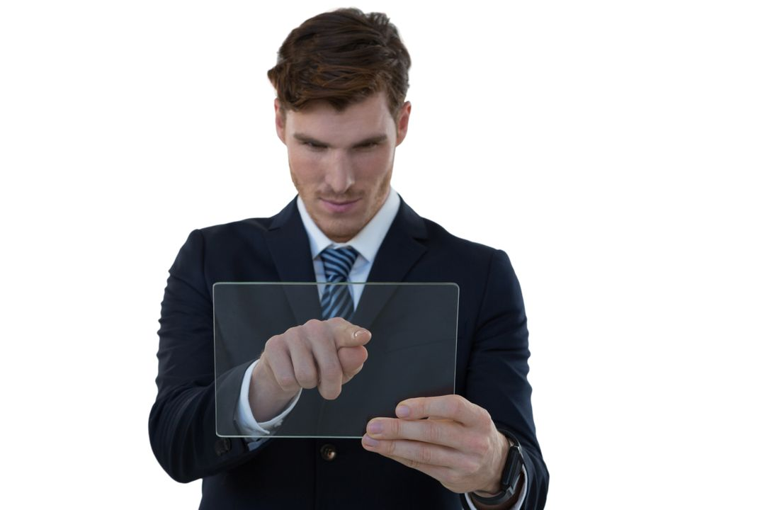 Businessman using glass digital tablet against white background