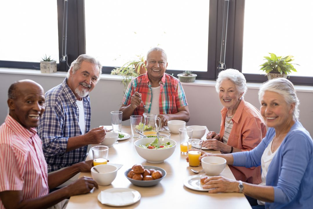 Portrait of senior people having breakfast at table in nursing home Free Stock Images from PikWizard