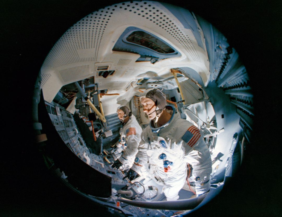 S69-19981 (23 Feb. 1969) --- Fish-eye camera lens view of the interior of the Apollo Lunar Module Mission Simulator (LMMS) at the Kennedy Space Center (KSC) during Apollo 9 simulation training. In the foreground is astronaut James A. McDivitt, prime crew commander; and in background is astronaut Russell L. Schweickart, lunar module pilot.
