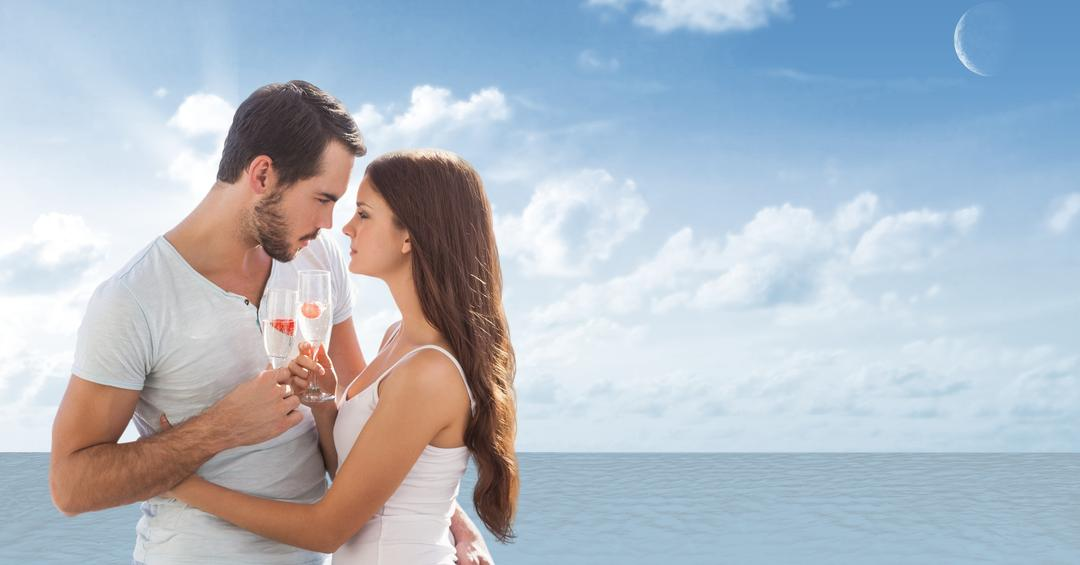 Digital composite of Loving couple having champagne at beach