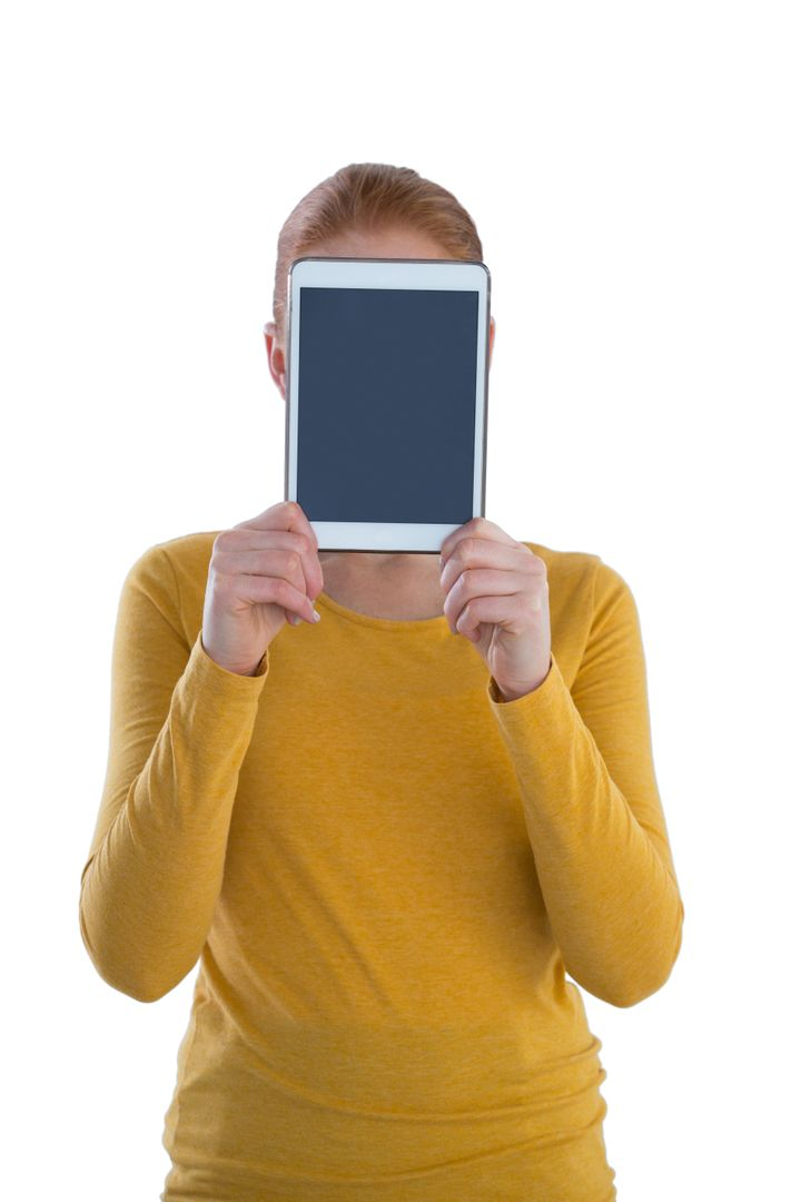 Businesswoman holding digital tablet in front of face while standing against white background Free Stock Images from PikWizard