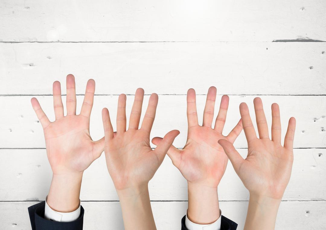 Digital composite of Many hands reaching against white wall
