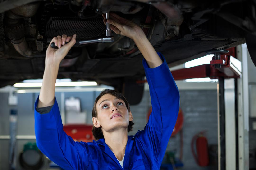 Female mechanic servicing a car in repair garage Free Stock Images from PikWizard