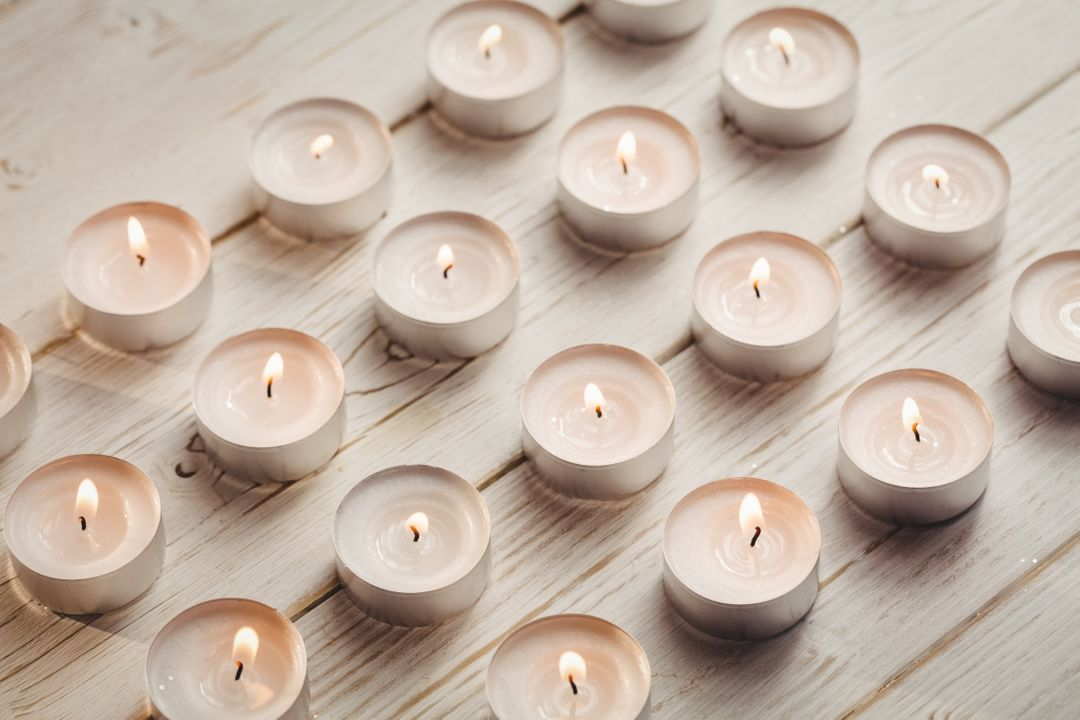 Candles burning on wooden table during christmas time Free Stock Images from PikWizard