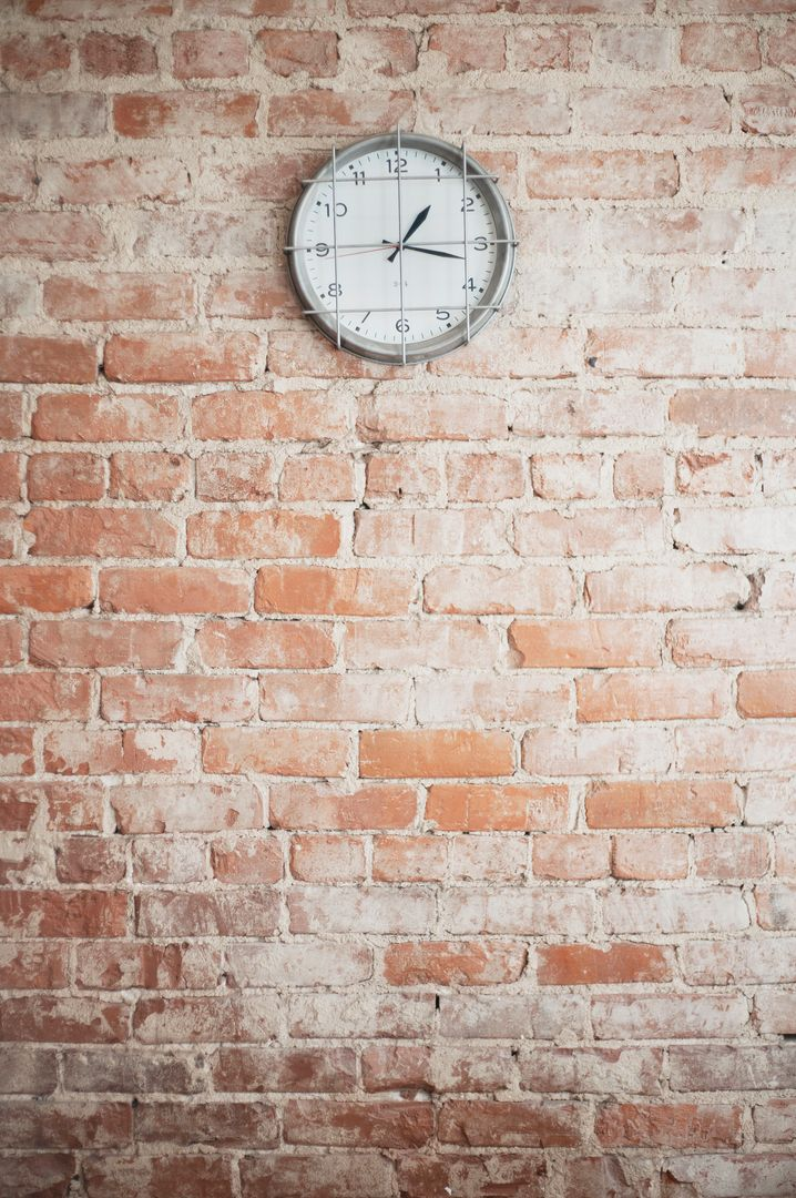 Low angle view of clock on brick wall