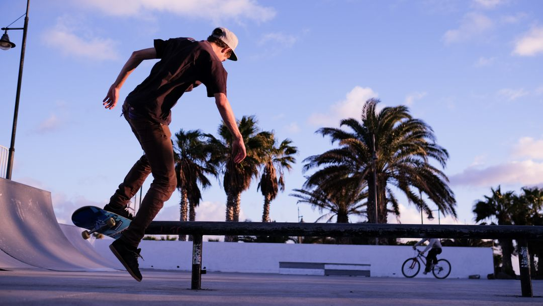 Photograph of man on a skateboard in skate park