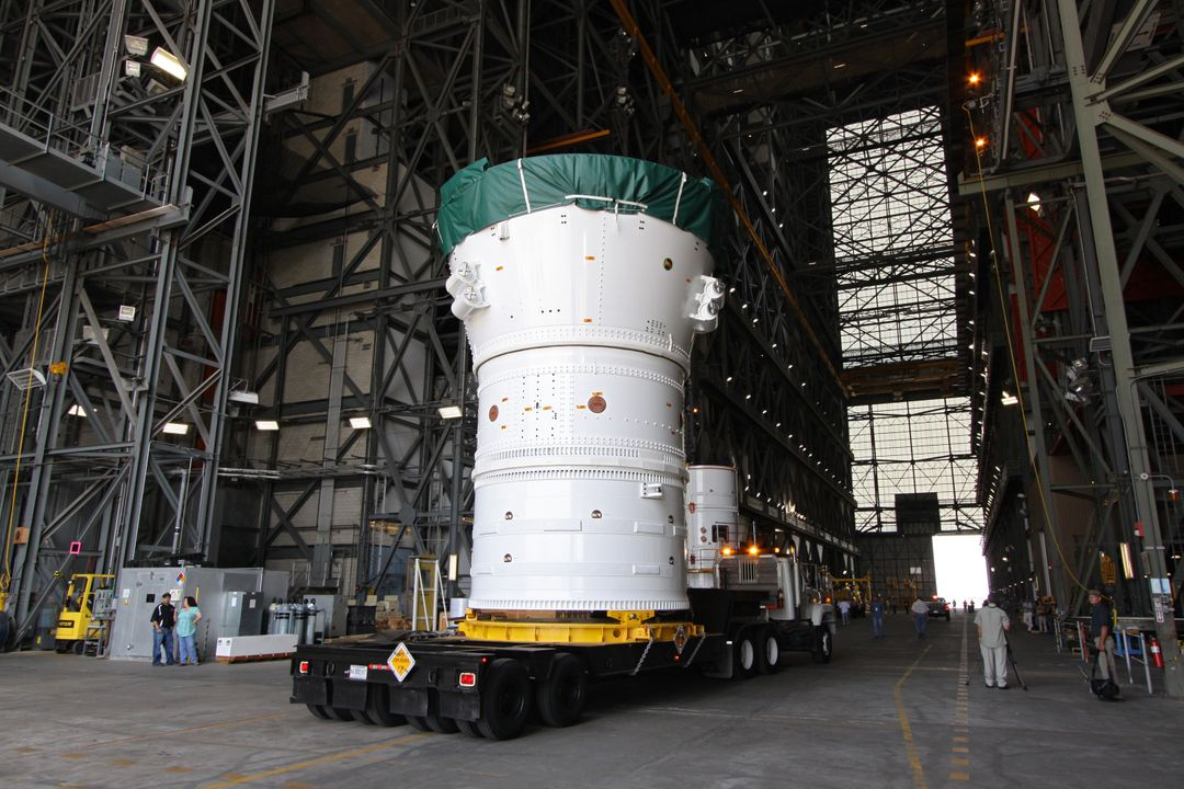 CAPE CANAVERAL, Fla. –  At NASA's Kennedy Space Center in Florida, the Ares I-X forward assembly comprising the frustum, forward skirt extension and forward skirt moves into the transfer aisle of the Vehicle Assembly Building.  The assembly will be placed in the VAB's High Bay 4 where it will undergo processing and stacking to the upper stage.  Ares I-X is the flight test for the Ares I which will provide NASA an early opportunity to test and prove hardware, facilities and ground operations associated with Ares I, which is part of the Constellation Program to return men to the moon and beyond. Launch of the Ares I-X flight test is targeted for August 2009.   Photo credit: NASA/Jack Pfaller