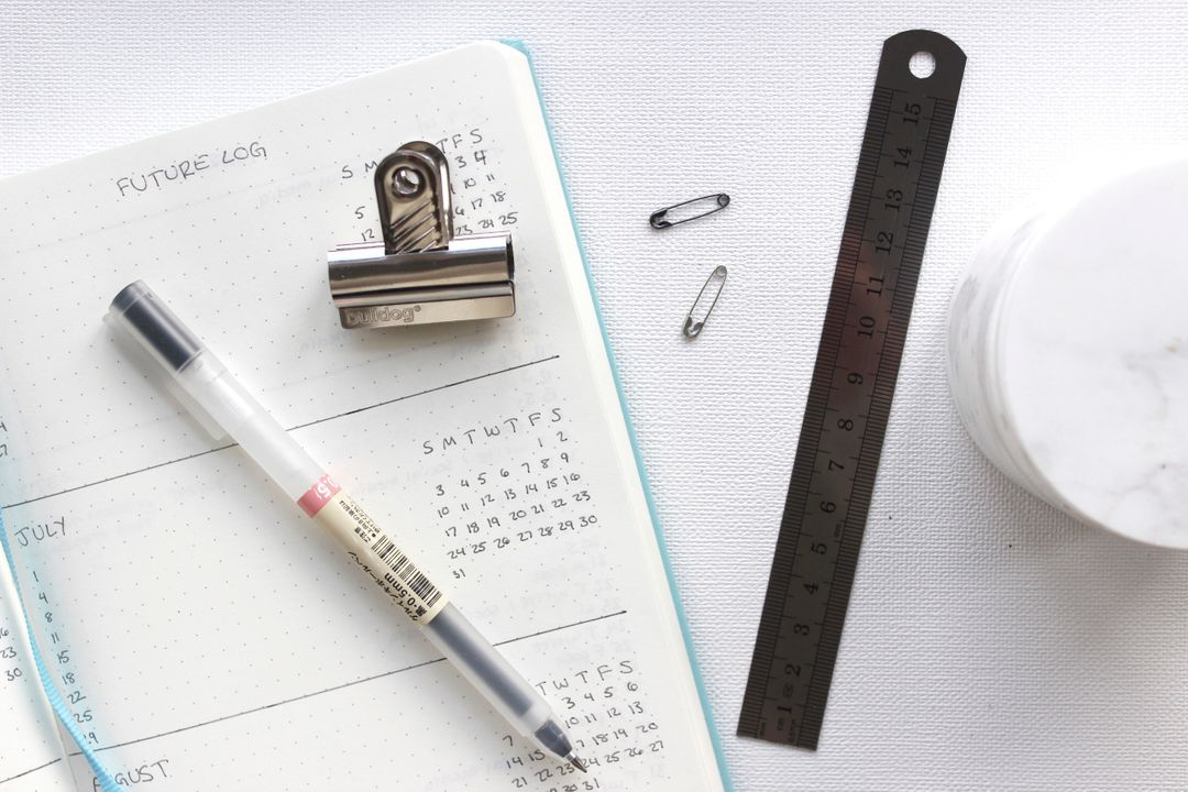Image of a Planner and a Pencil