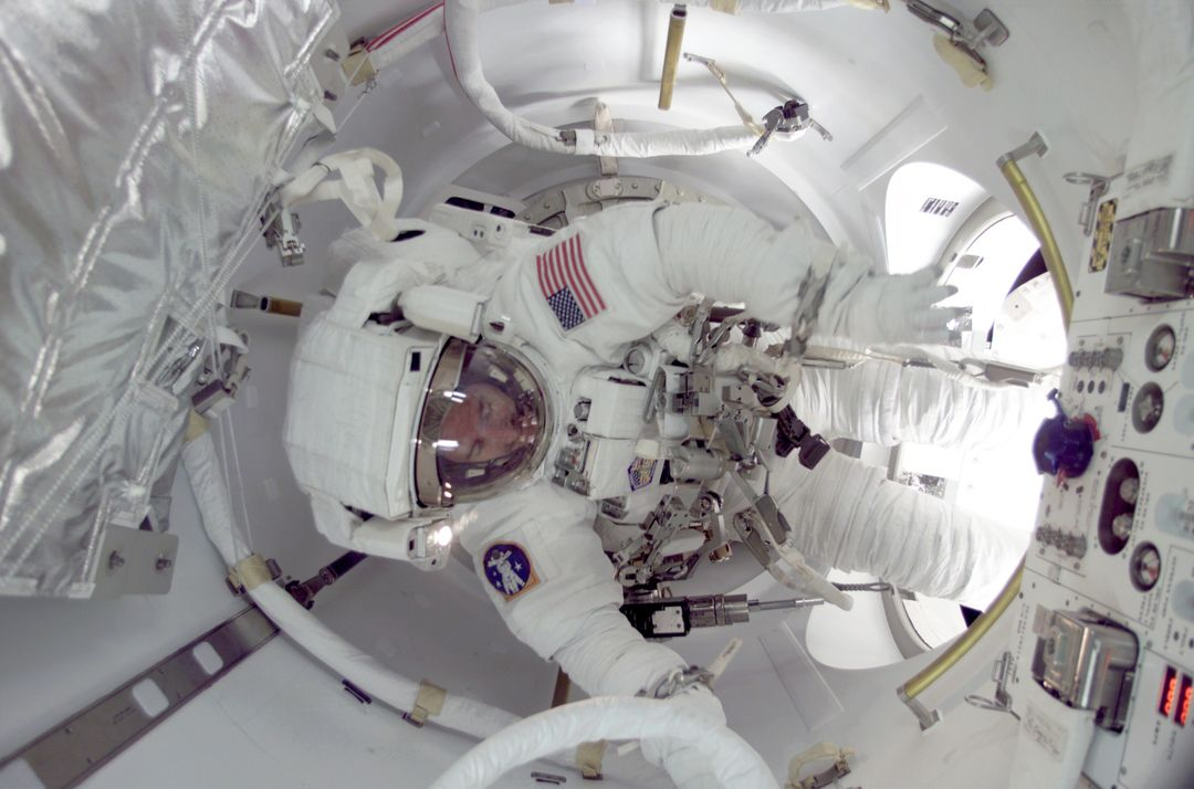 Astronaut James F. Reilly participated in the first ever space walk to egress from the International Space Station (ISS) by utilizing the newly-installed Joint Airlock Quest. The Joint Airlock is a pressurized flight element consisting of two cylindrical chambers attached end-to-end by a cornecting bulkhead and hatch. Once installed and activated, the ISS Airlock becomes the primary path for ISS space walk entry and departure for U.S. spacesuits, which are known as Extravehicular Mobility Units (EMUs). In addition, it is designed to support the Russian Orlan spacesuit for extravehicular activity (EVA). The Joint Airlock is 20-feet long, 13- feet in diameter and weighs 6.5 tons. It was built at the Marshall Space Flight Center (MSFC) by the Space Station prime contractor Boeing. The ISS Airlock has two main components: a crew airlock and an equipment airlock for storing EVA and EVA preflight preps. The Airlock was launched on July 21, 2001 aboard the Space Shuttle Orbiter Atlantis for the STS-104 mission.