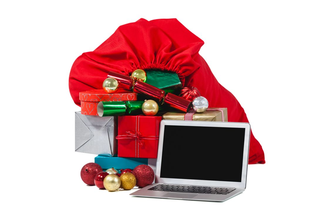 Santa bag filled with surprised gifts and laptop against white background
