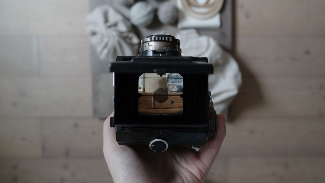 Image of a camera taking a picture of a product on a wooden surface