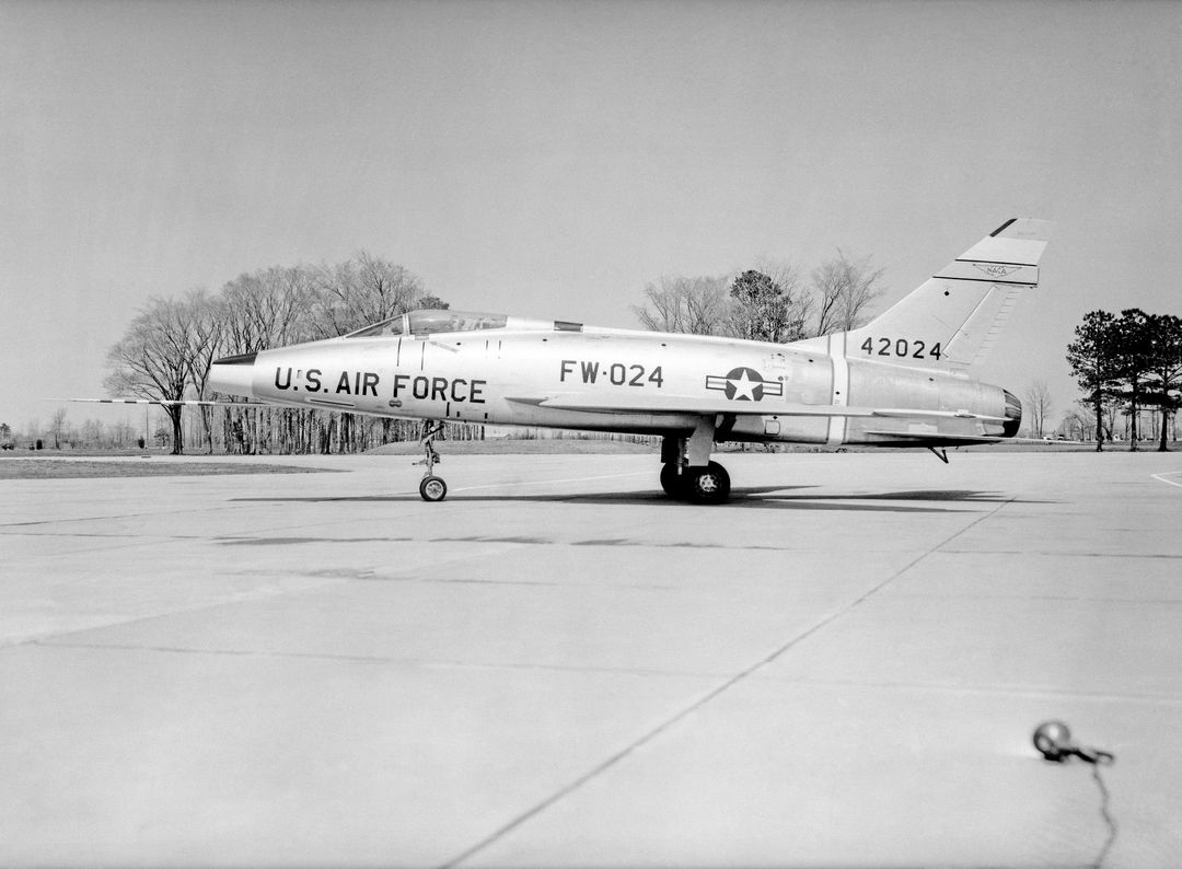 North American F-100 C airplane used in sonic boom investigation at Wallops, October 7, 1958.  Photograph published in: A New Dimension  Wallops Island Flight Test Range: The First Fifteen Years by Joseph Shortal. A NASA publication. Page 672. -- Aircraft number: NACA 42024. Side view, 3/4 view from front, 3/4 view from rear, rear view, and two front views.