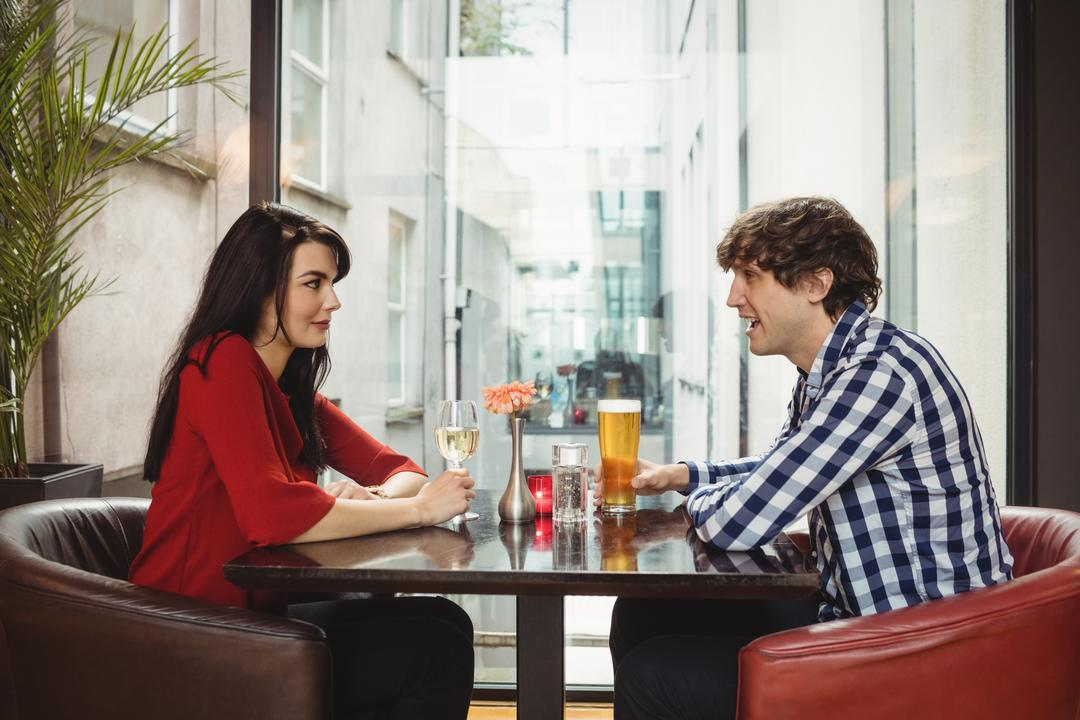 Couple having drinks together in bar