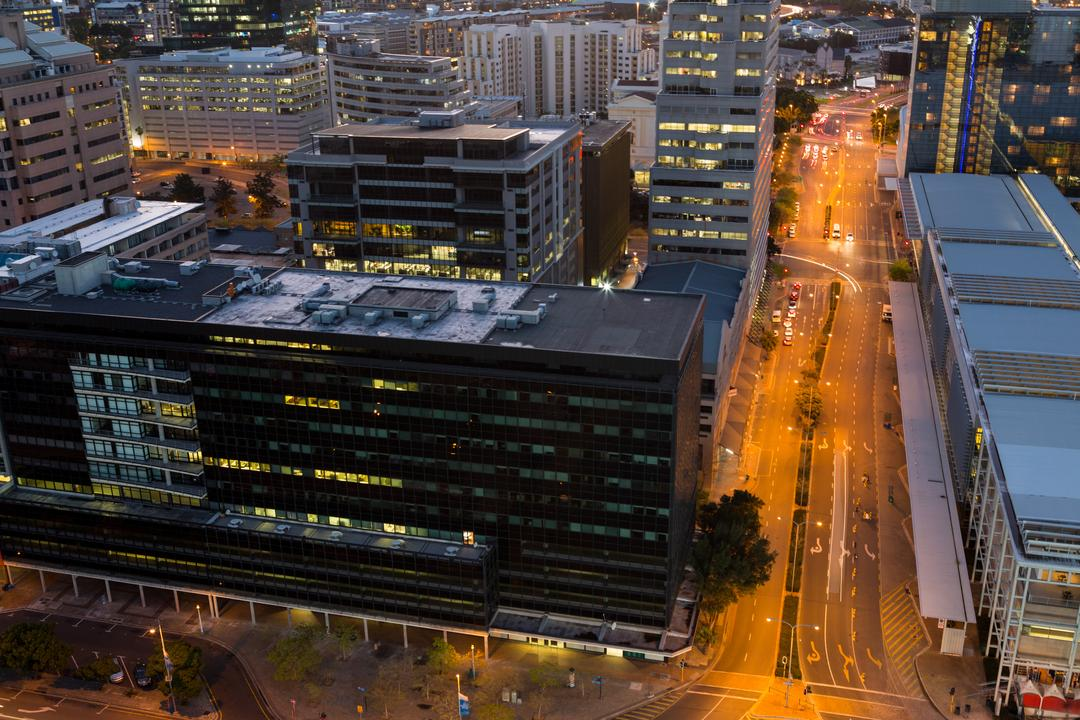 Aerial view of streets and office building in business district at night