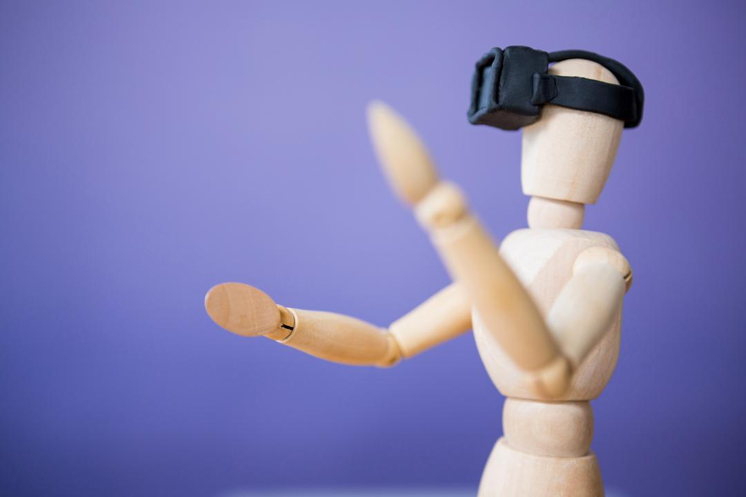 Close-up of figurine using a virtual reality headset