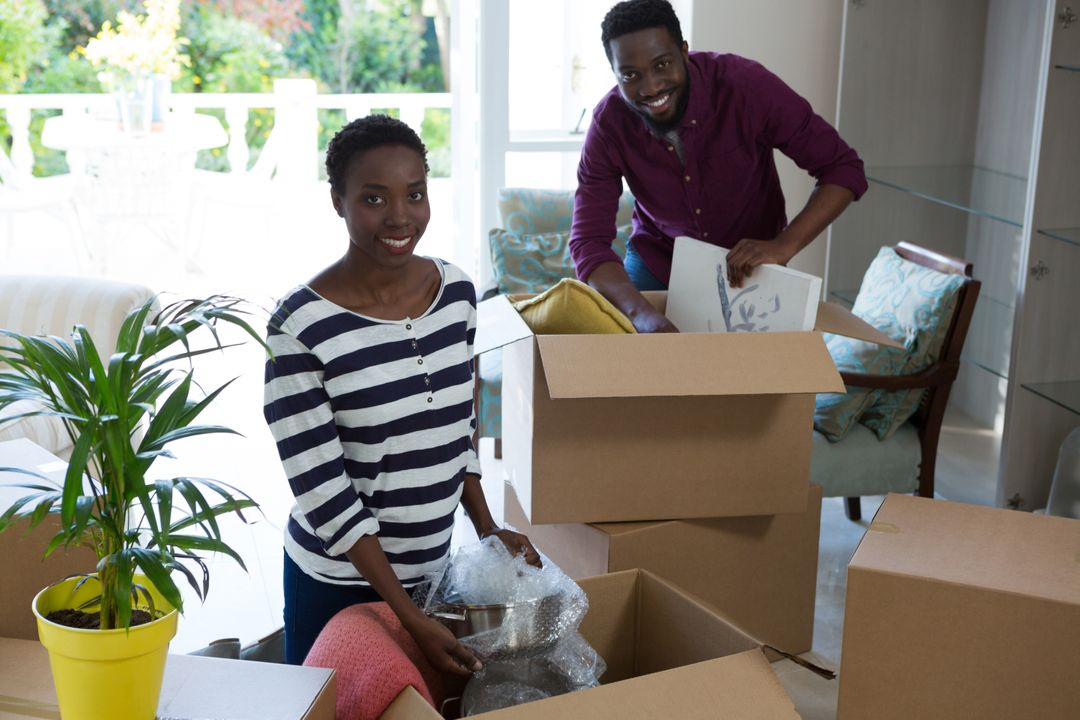 Portrait of happy couple unpacking boxes Free Stock Images from PikWizard