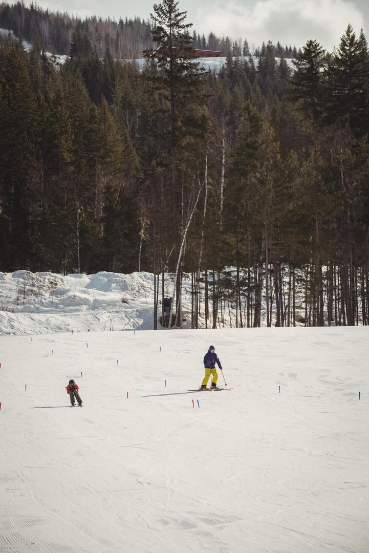 Father and son skiing on snowy alps during winter Free Stock Images from PikWizard