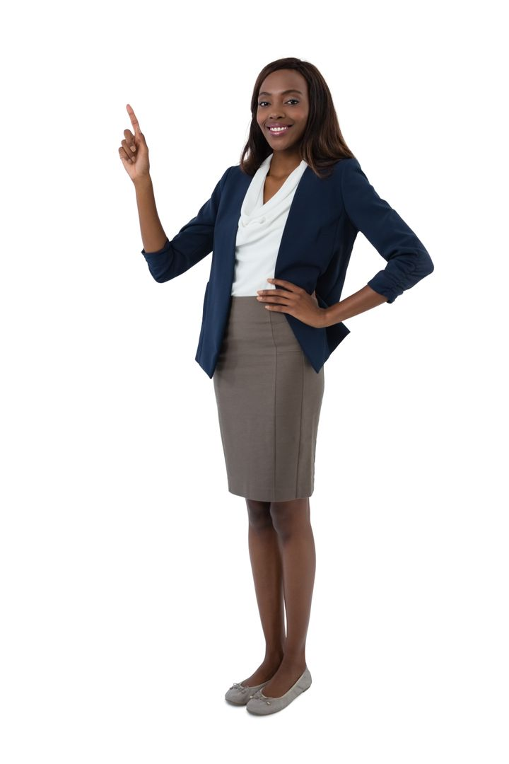 Portrait of smiling businesswoman with hand on hip gesturing while giving presentation against white background Free Stock Images from PikWizard
