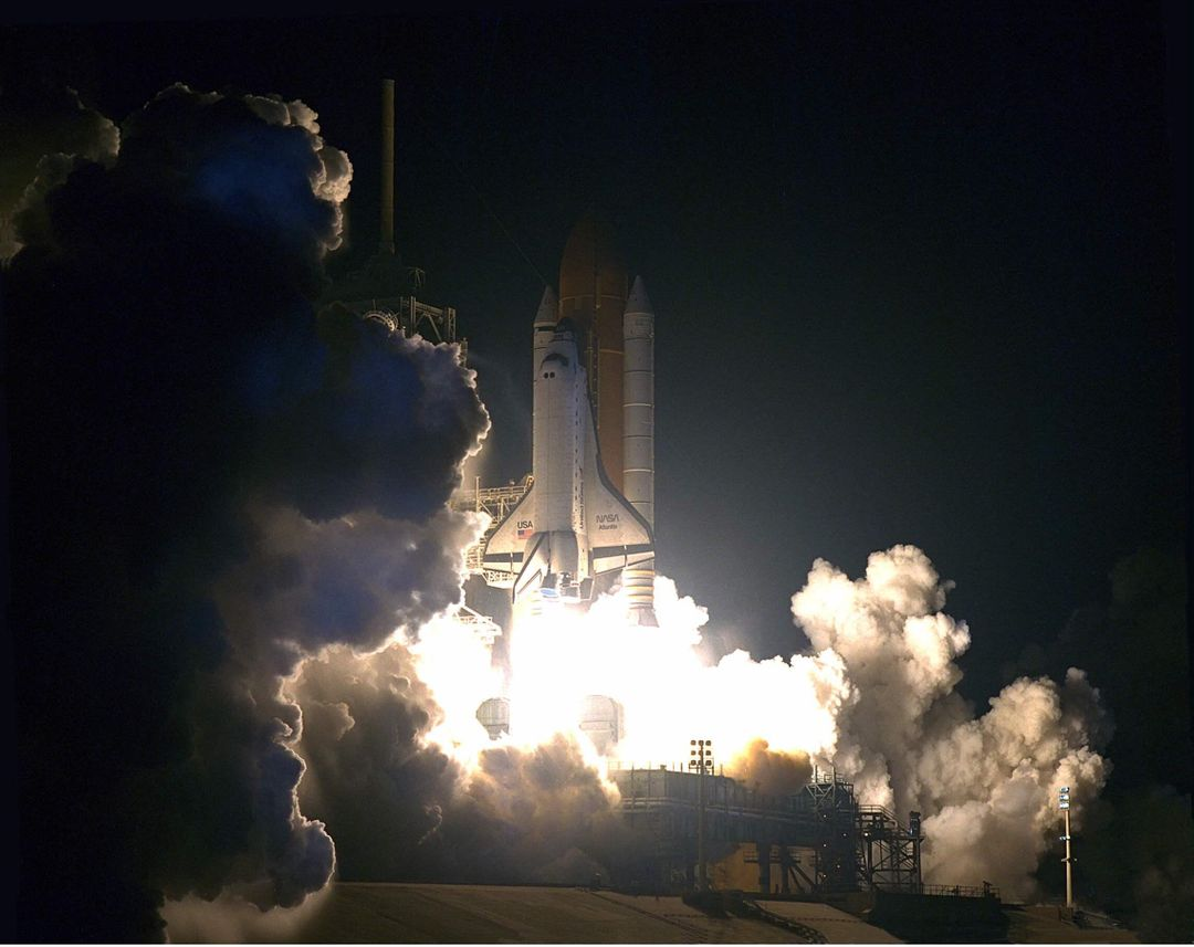 The Space Shuttle Atlantis turns night into day for a few moments as it lifts off on May 15 at 4:07:48 a.m. EDT from Launch Pad 39A on the STS-84 mission. The fourth Shuttle mission of 1997 will be the sixth docking of the Space Shuttle with the Russian Space Station Mir. The commander is Charles J. Precourt. The pilot is Eileen Marie Collins. The five mission specialists are C. Michael Foale, Carlos I. Noriega, Edward Tsang Lu, Jean-Francois Clervoy of the European Space Agency and Elena V. Kondakova of the Russian Space Agency. The planned nine-day mission will include the exchange of Foale for U.S. Astronaut and Mir 23 crew member Jerry M. Linenger, who has been on Mir since Jan. 15. Linenger transferred to Mir during the last docking mission, STS-81; he will return to Earth on Atlantis. Foale is slated to remain on Mir for about four months until he is replaced in September by STS-86 Mission Specialist Wendy B. Lawrence. During the five days Atlantis is scheduled to be docked with the Mir, the STS-84 crew and the Mir 23 crew, including two Russian cosmonauts, Commander Vasily Tsibliev and Flight Engineer Alexander Lazutkin, will participate in joint experiments. The STS-84 mission also will involve the transfer of more than 7,300 pounds of water, logistics and science equipment to and from the Mir. Atlantis is carrying a nearly 300-pound oxygen generator to replace one of two Mir units which have experienced malfunctions. The oxygen it generates is used for breathing by the Mir crew