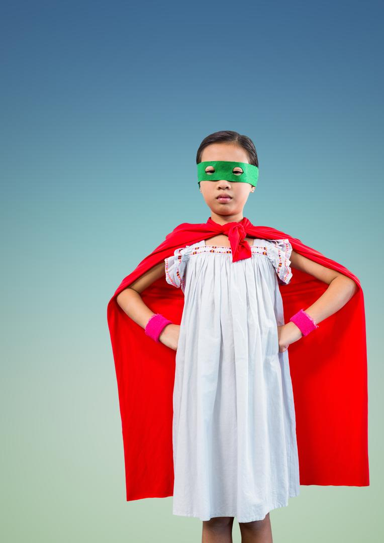 Portrait of a superhero kid in red cape and green eye mask