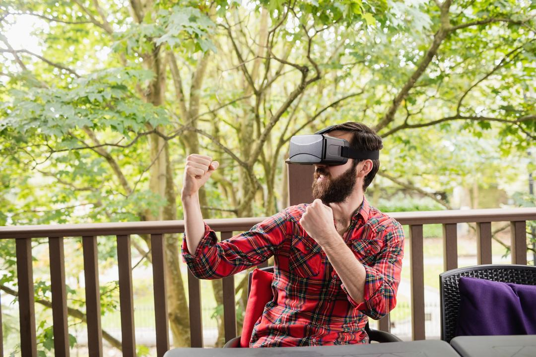 Man using virtual reality headset in bar