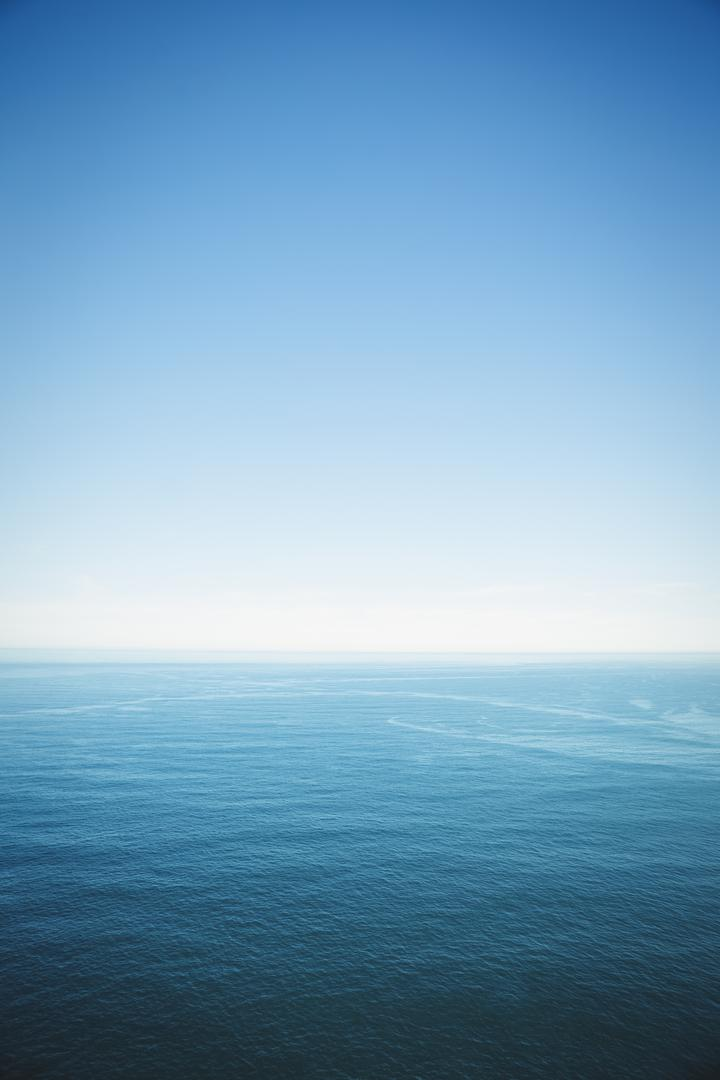 View of sea under clear blue sky