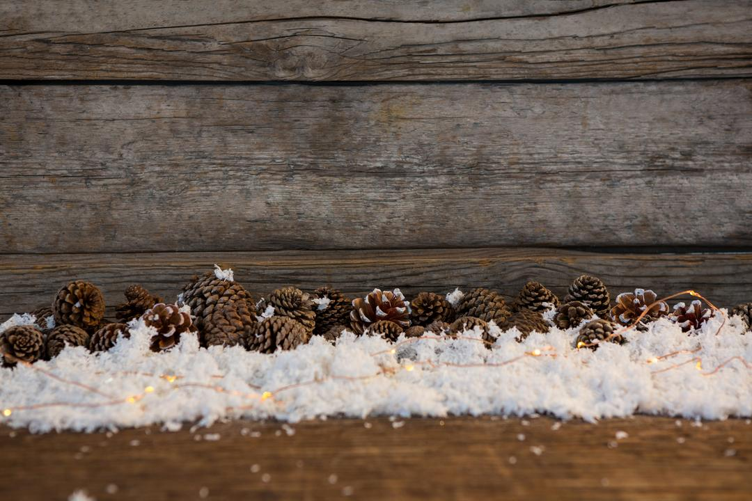Pine cone decoration on fake snow