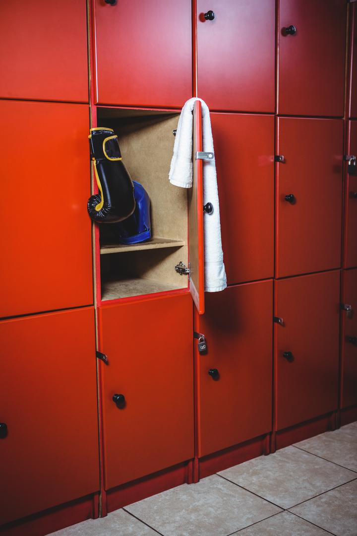 Boxing gloves and a towel in locker room at fitness studio