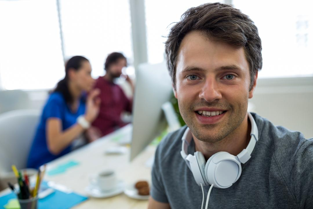 Portrait of male graphic designer smiling in office