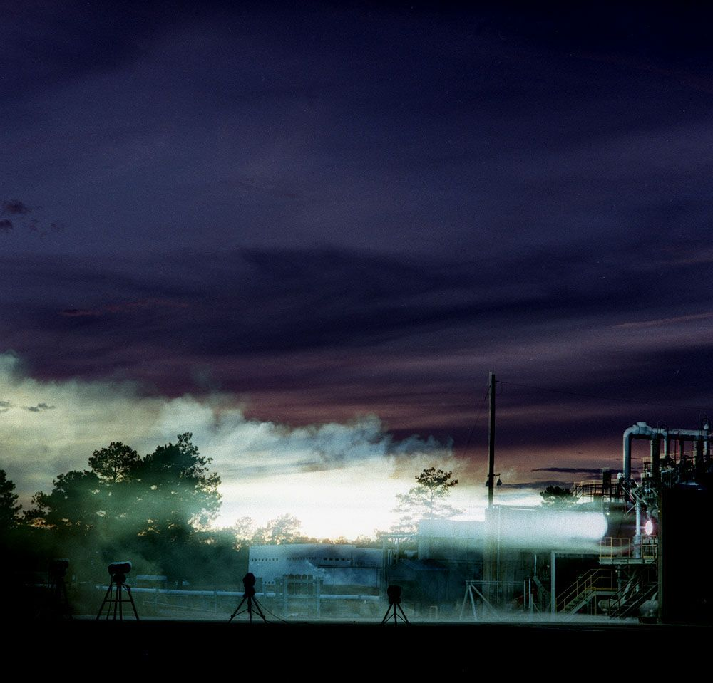 750 K motor test firing at Marshall's Test Stand 116 developing 650 pounds of thrust. The motor was tested for the Air Force Expendable Launch Vehicle (ELV) project.