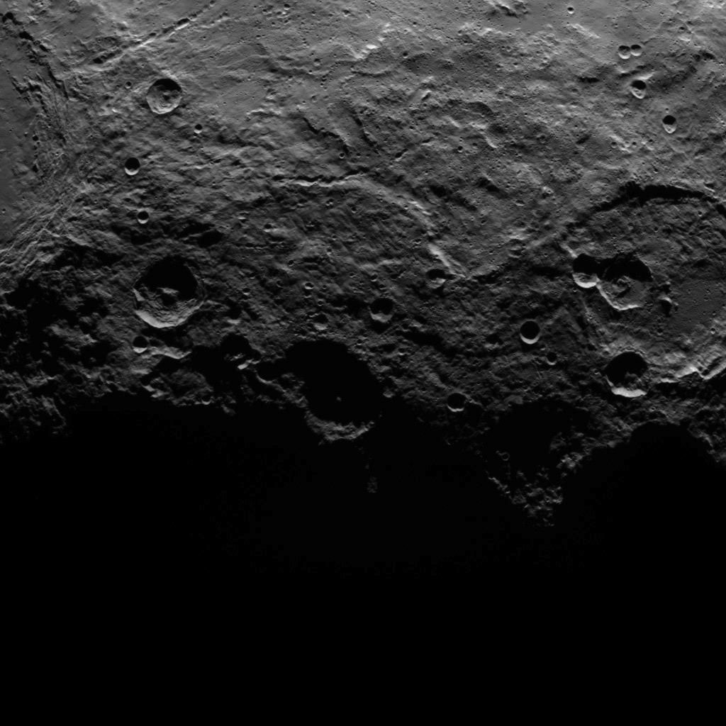 This image, taken by NASA's Dawn spacecraft, shows a portion of the southern hemisphere of dwarf planet Ceres from an altitude of 2,700 miles (4,400 kilometers). The image, with a resolution of 1,400 feet (410 meters) per pixel, was taken on June 25, 2015.  The image was obtained on June 25, 2015 from an altitude of 2,700 miles (4,400 kilometers) above Ceres and has a resolution of 1,400 feet (410 meters) per pixel.   http://photojournal.jpl.nasa.gov/catalog/PIA19616