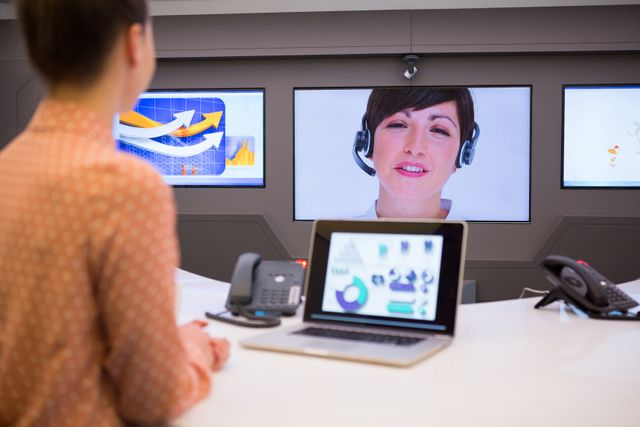 Female executive having video call in boardroom