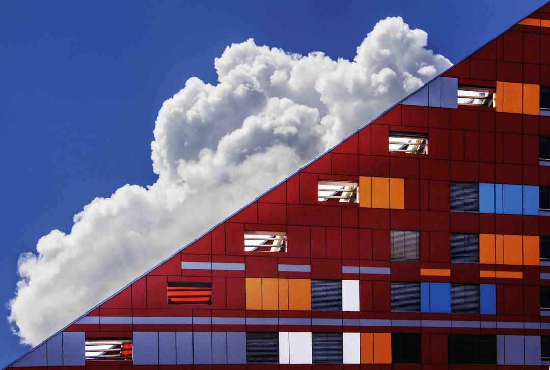Abstract image with colorful windows and cloudy sky