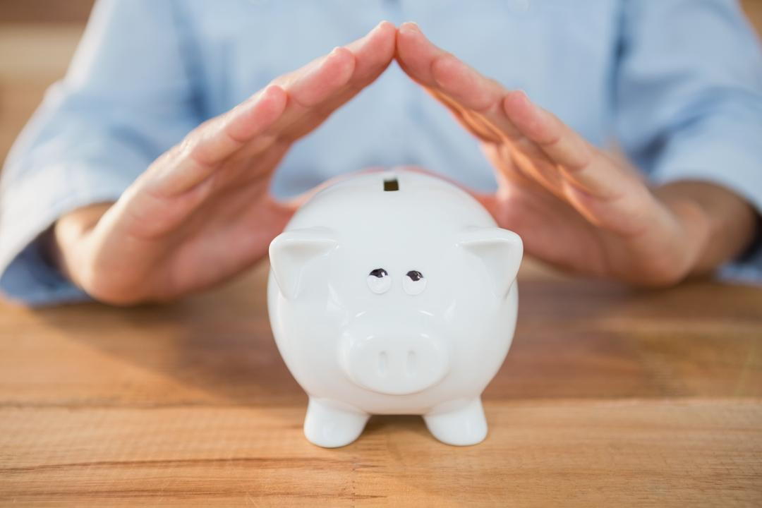 Mid section of man making a roof gesture on piggy bank Free Stock Images from PikWizard
