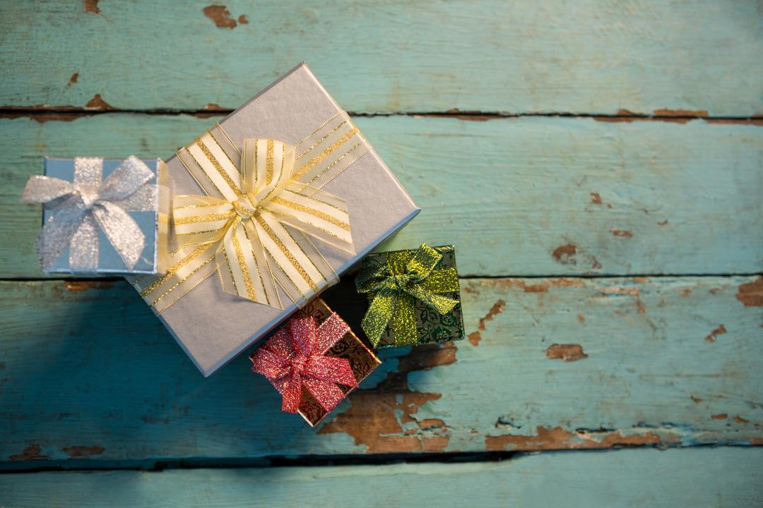 Wrapped gifts on wooden plank during christmas time