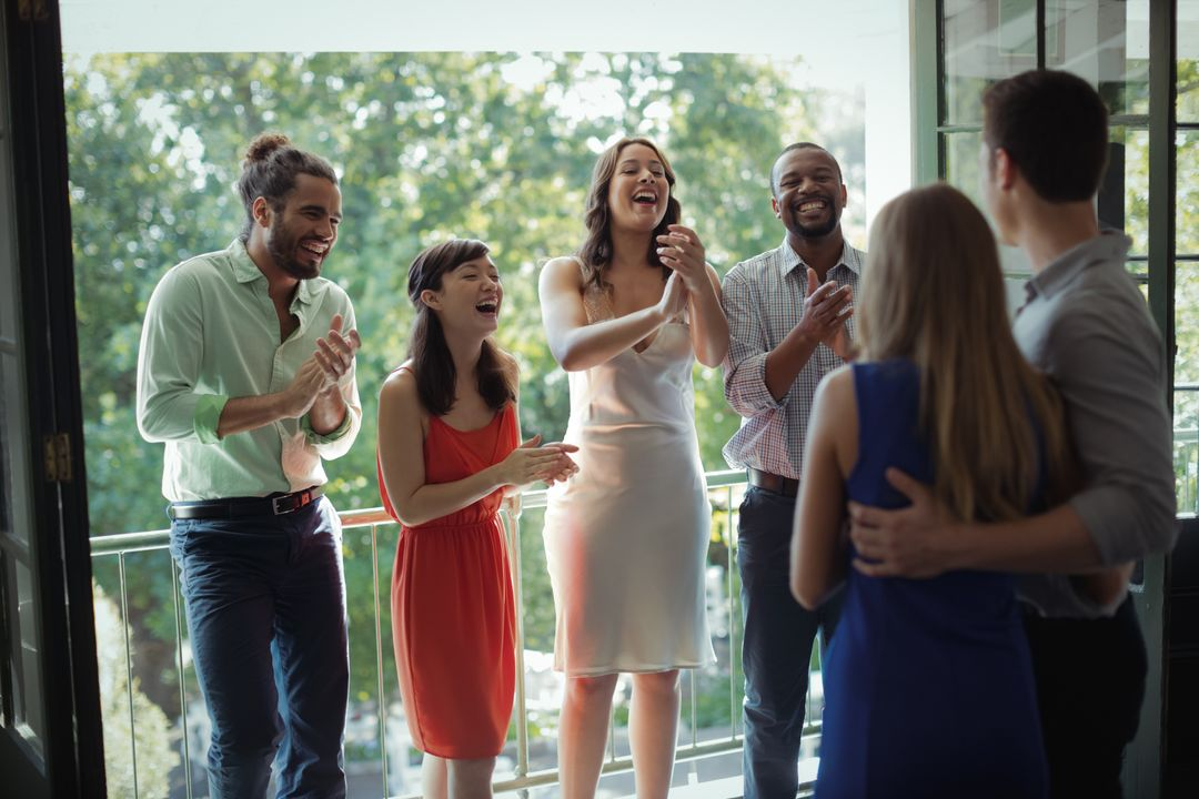 Group of friends applauding couple during party in restaurant Free Stock Images from PikWizard