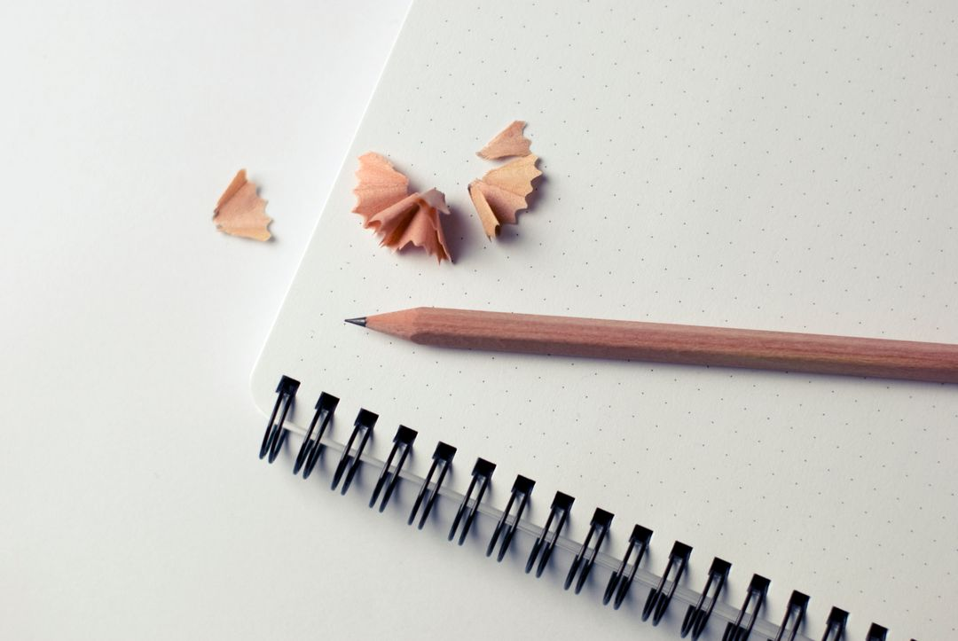 Image of a Sharpened Pencil on a Notebook