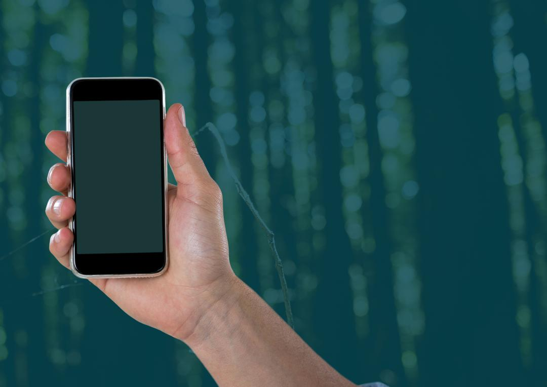 Digital composite of Hand with phone against forest