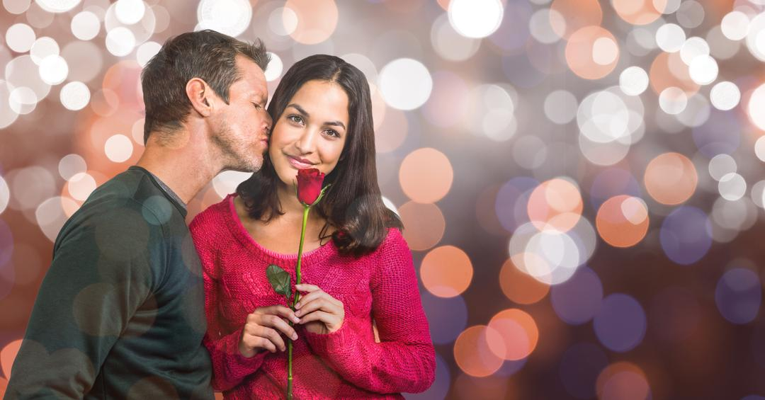 Digital composite of Portrait of smiling woman holding rose while man kissing her over bokeh background Free Stock Images from PikWizard