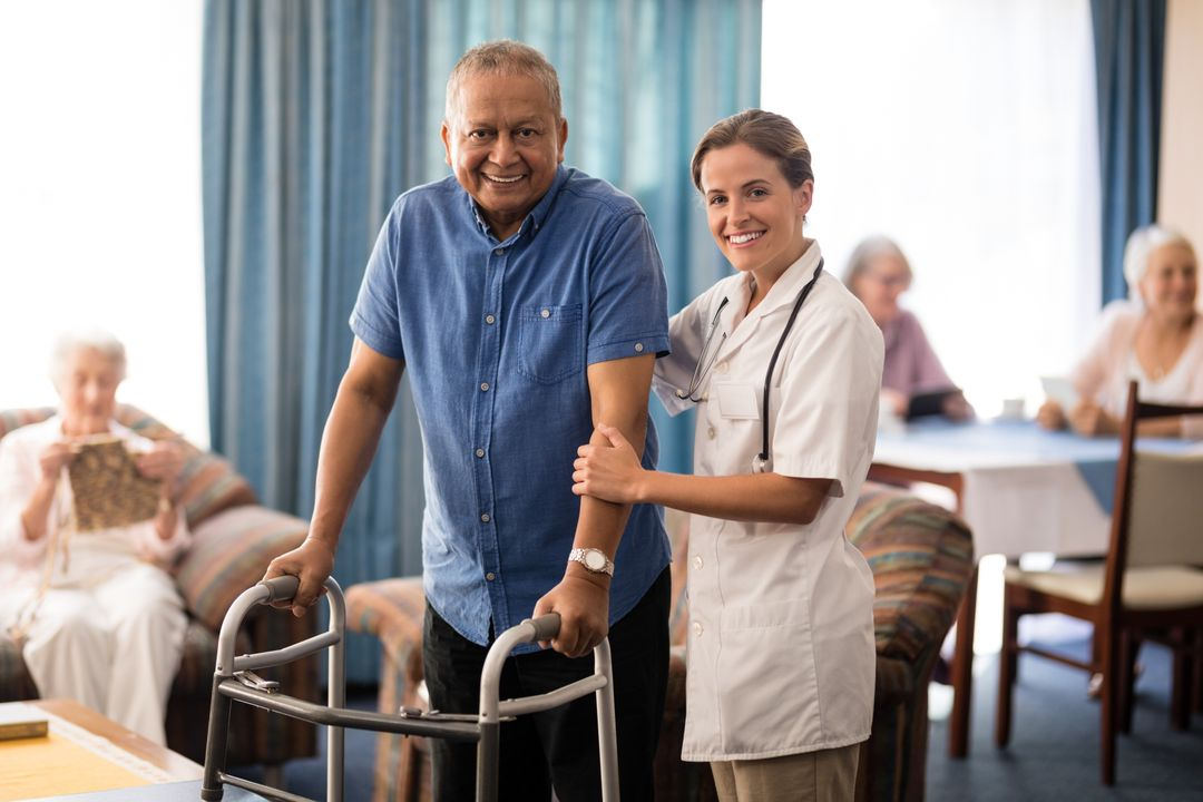 Portrait of smiling female doctor standing by senior man with walker at retirement home